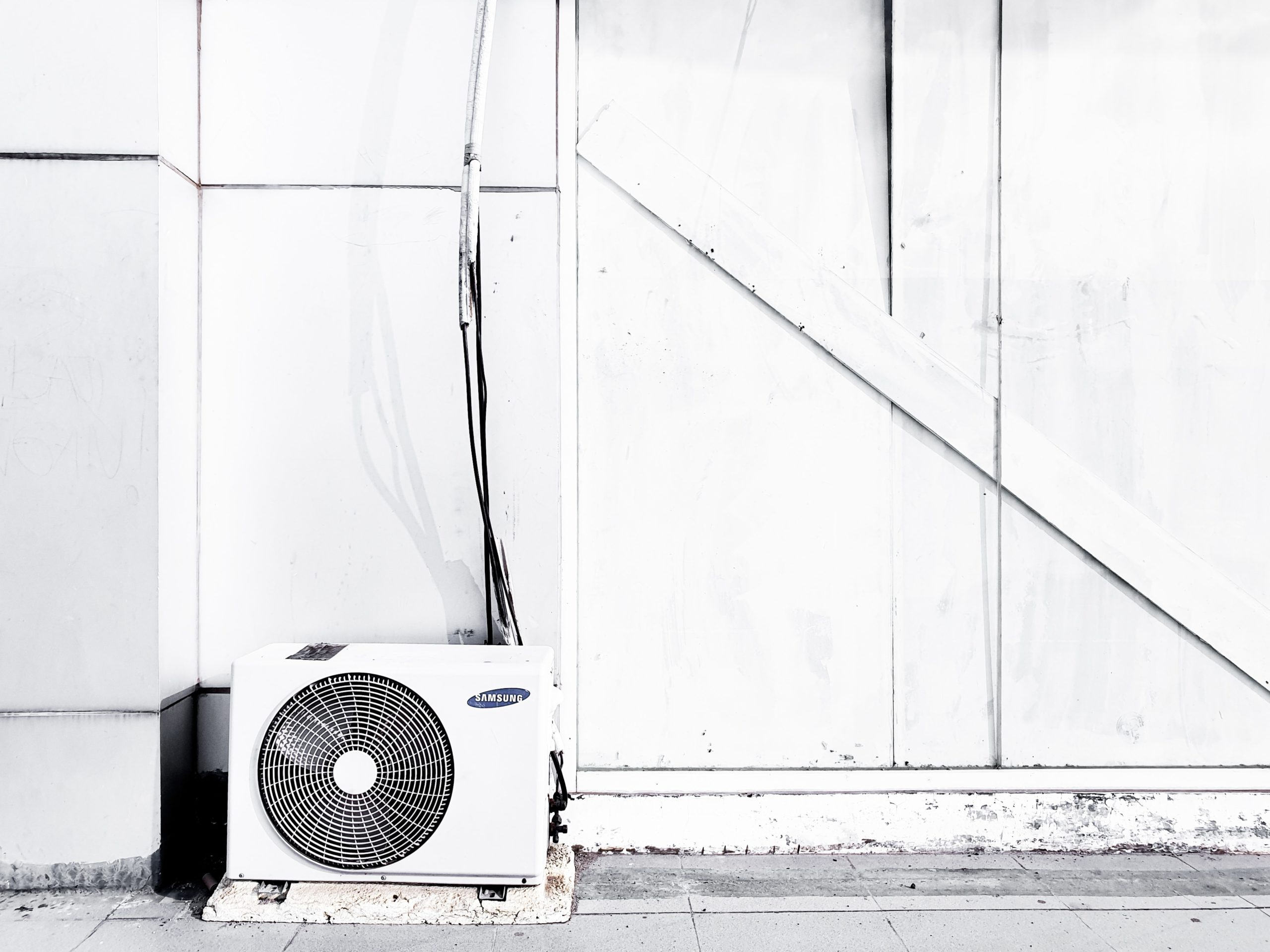 air conditioner outside a room on the ground